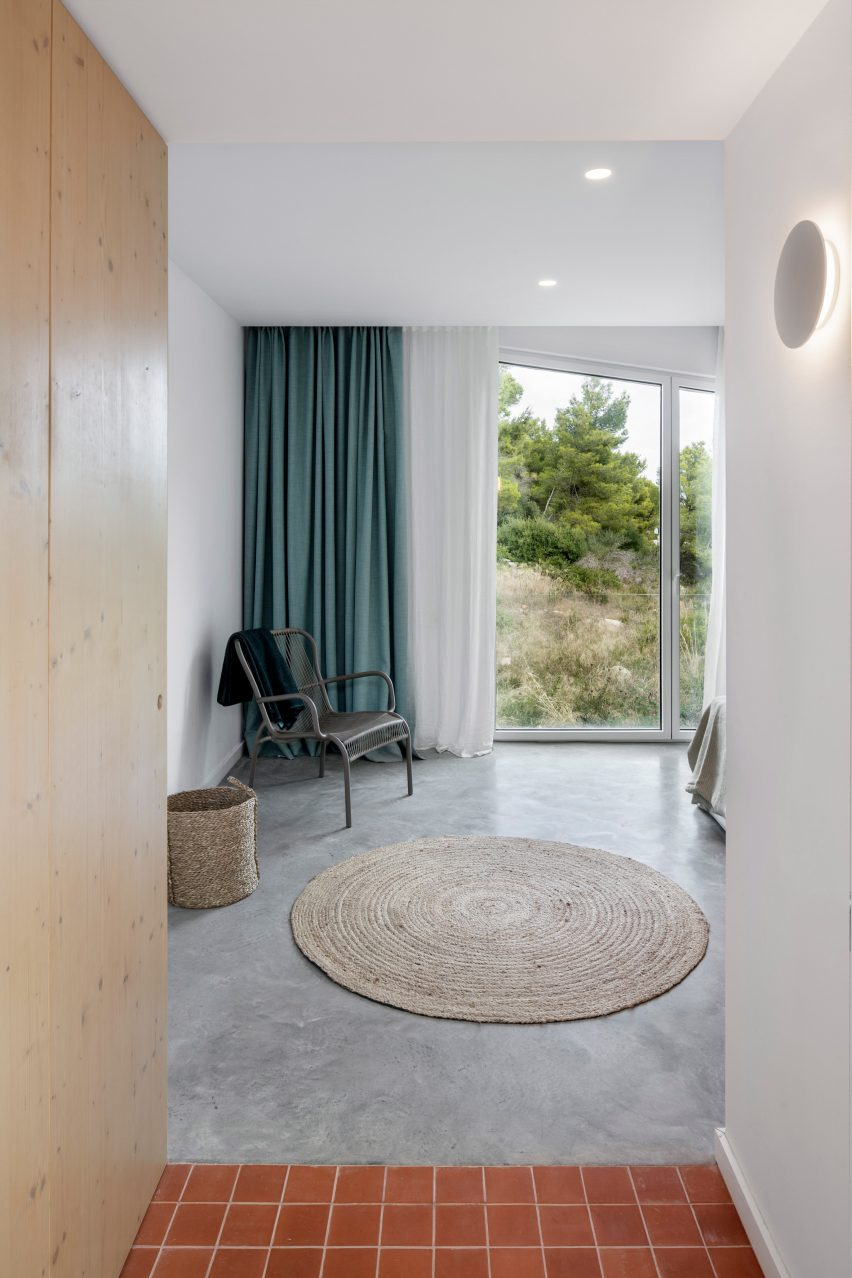 Terracotta tiles and concrete cover the floors at Curved House