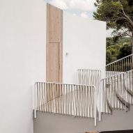 A stepped bridge leads to the home