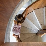 The staircase has terrazzo steps