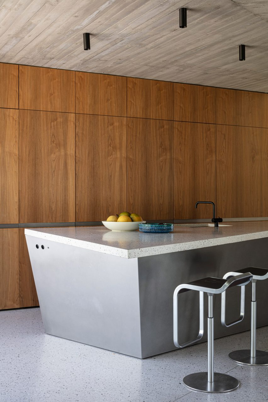 Wood panels line the walls of House Dede's kitchen