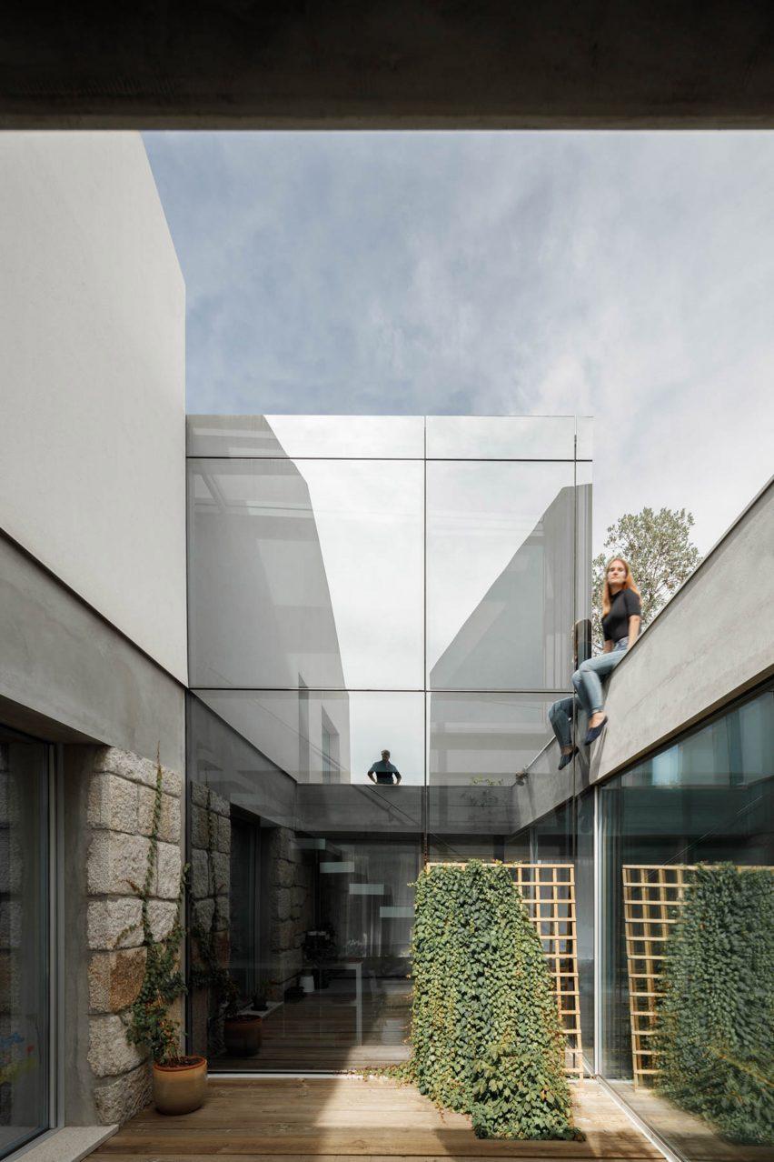 A glazed wall of Casa Rio reflects its surroundings
