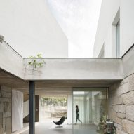 Glazed walls allow light to flood into the home