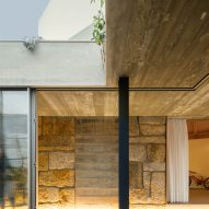 Sliding doors connect the interior and exterior