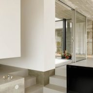 Concrete steps lead into the sunken living space
