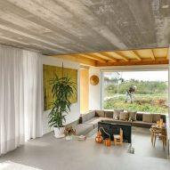 A sunken living area overlooks greenery
