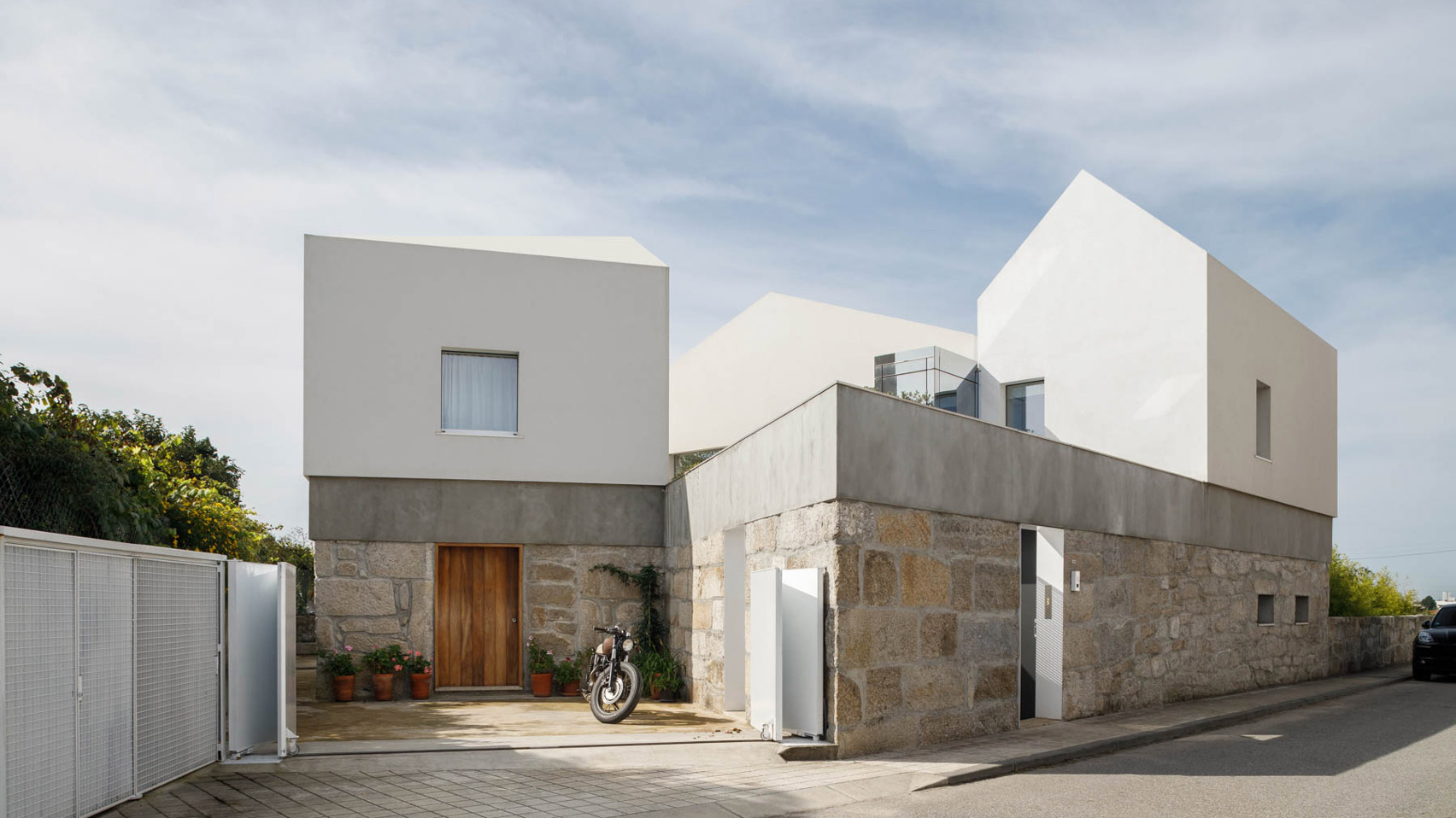 The home has a stone and white rendered exterior