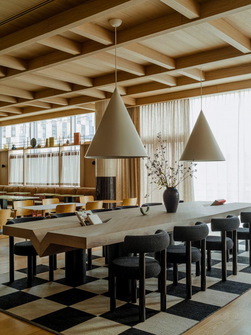 Communal seating in hotel interior by Studio Paradowski