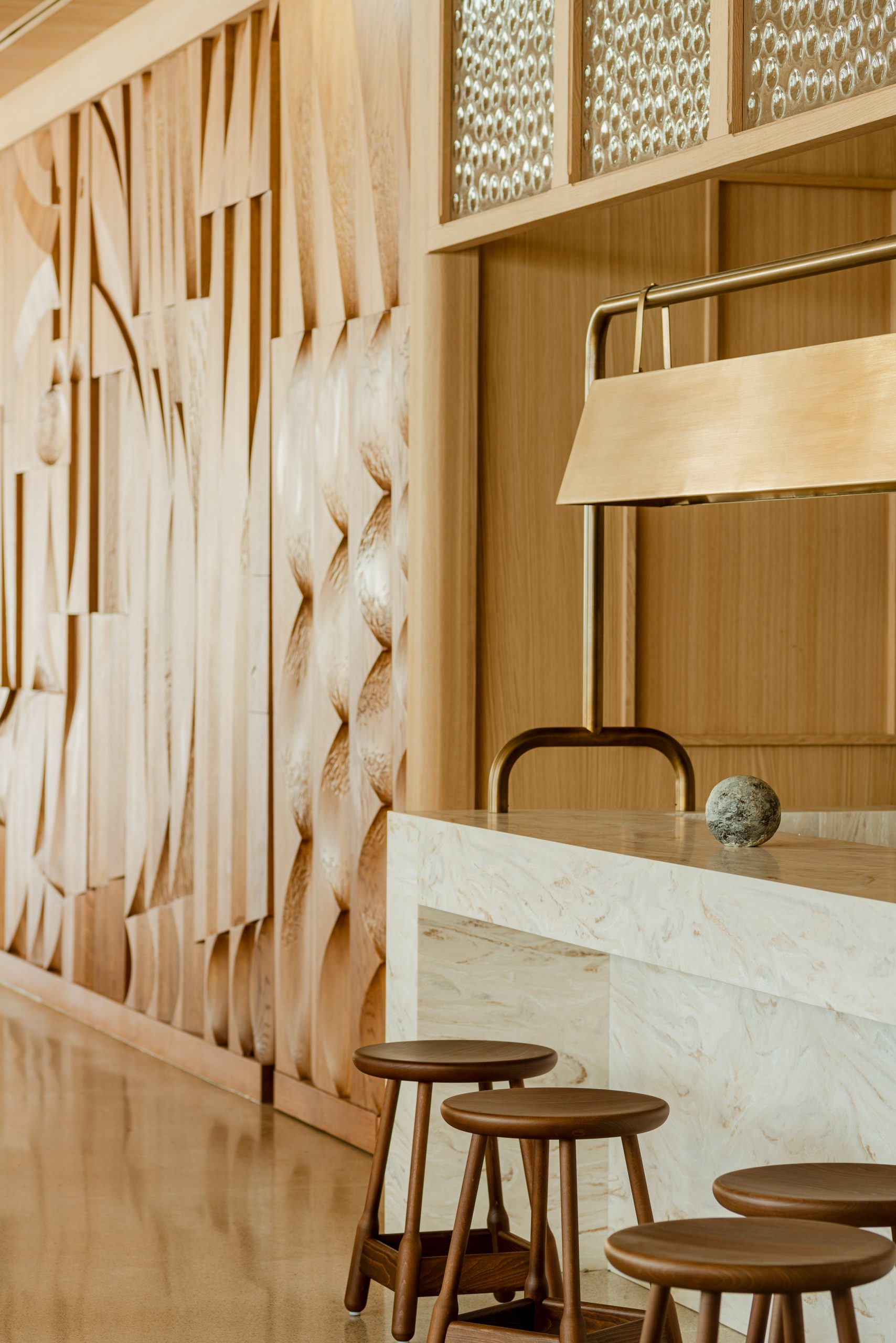 Wooden bas-relief wall and counter seating in Puro Hotel Stare Miasto