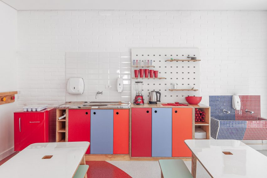 Bright cabinets line the classrooms