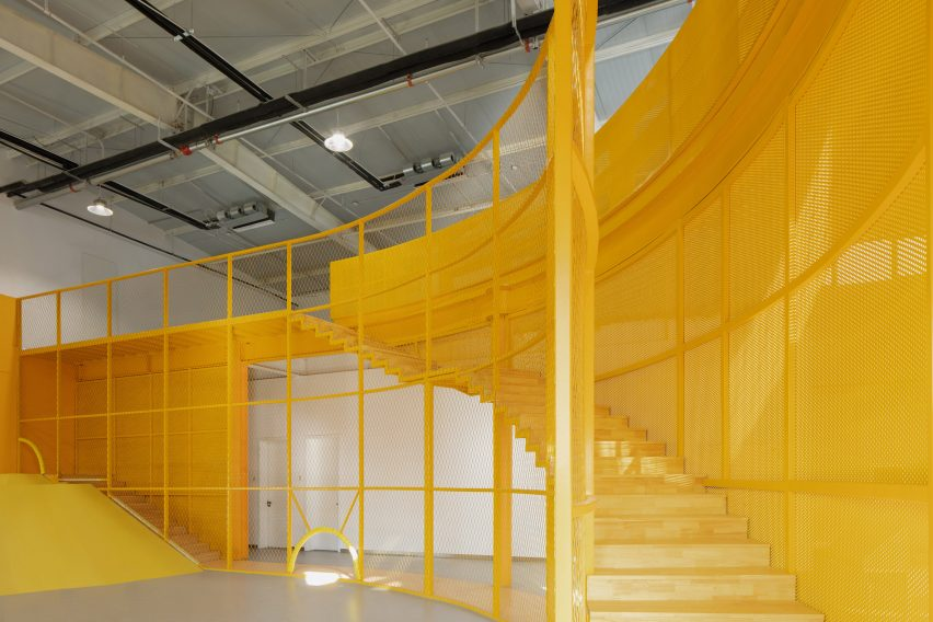 A yellow steel staircase