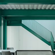 An interior with green-painted steel