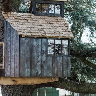 Scorched large wood cladding and roof shingles