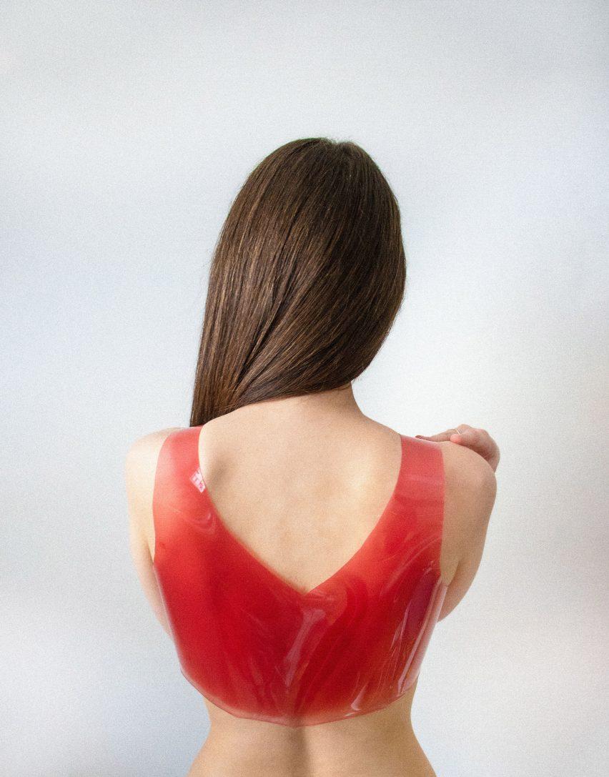 Woman wearing shiny gelatinous top by Valdís Steinarsdóttir