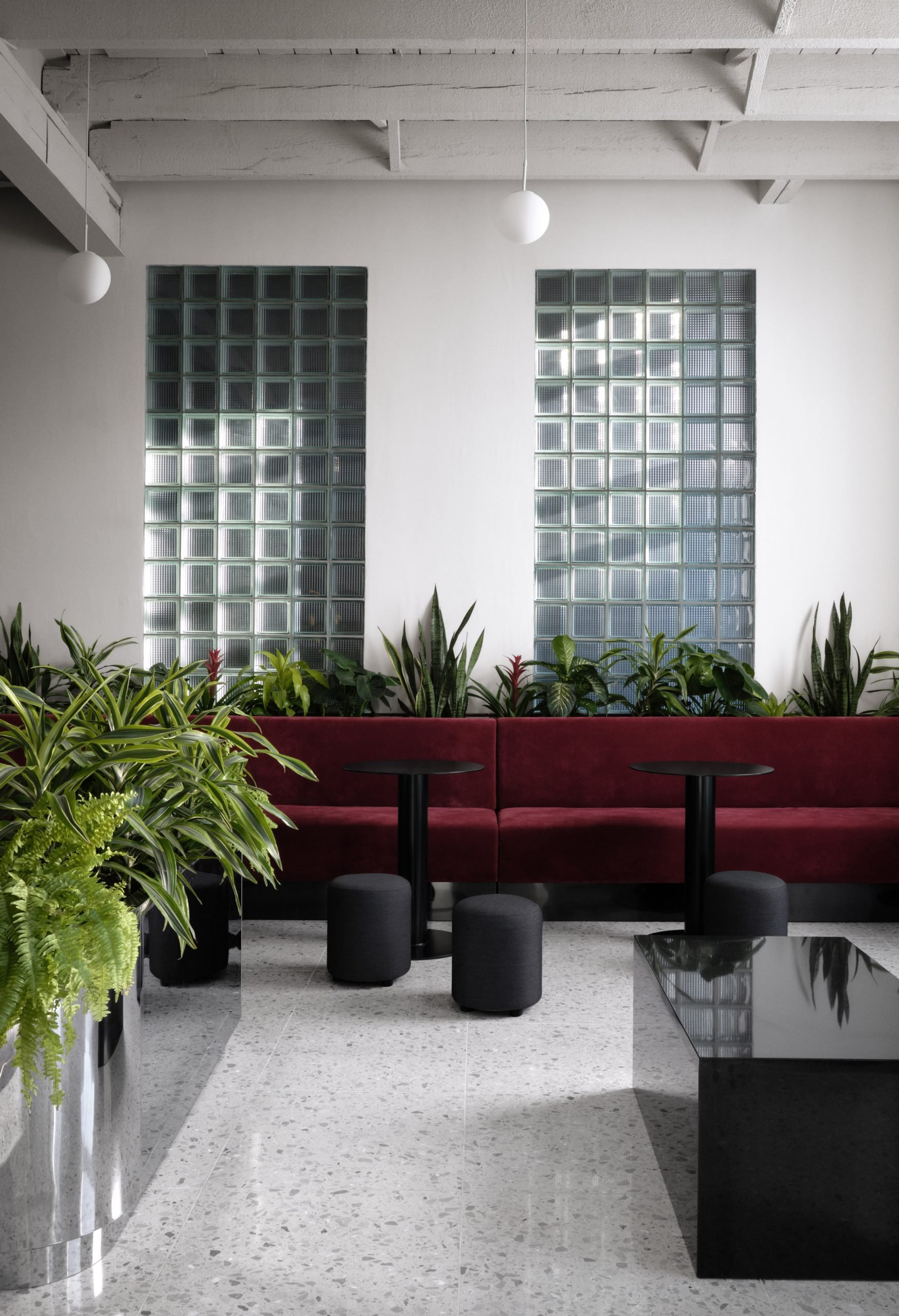 Ivy Studio put a glass-brick wall in the reception