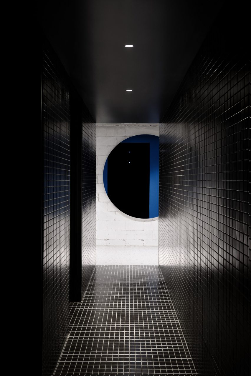 Bathrooms have black tiles and pops of colour