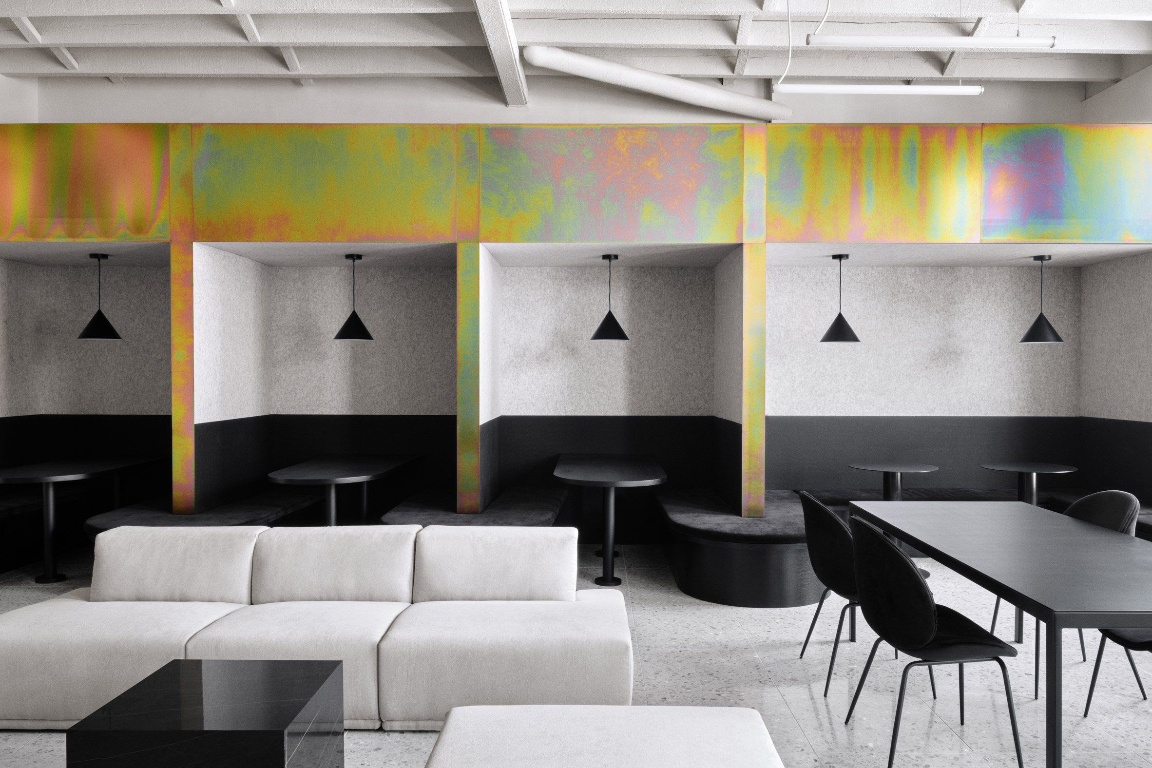Rainbow-coloured elements feature in the office