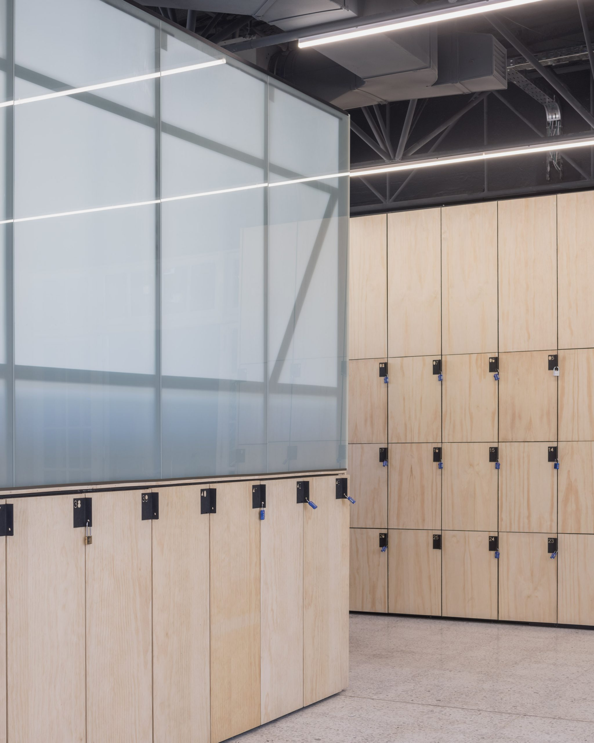 Fintual's office by Studio Cáceres Lazo is lined with functional lockers