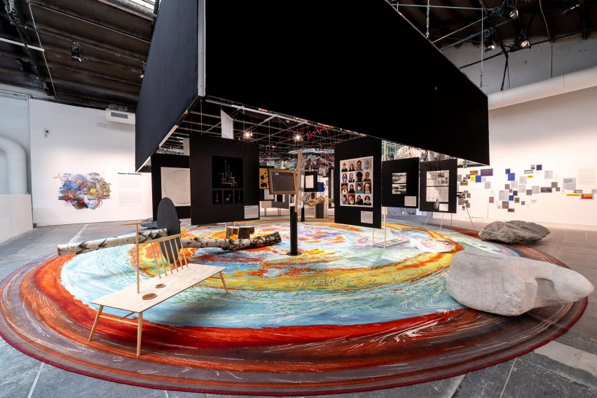 A circular rug covers the floor of the Future Assembly installation