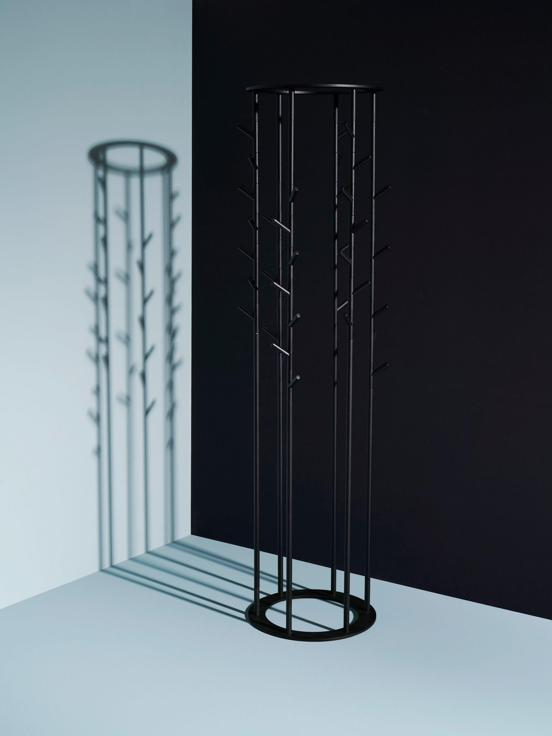 A black circular coat stand