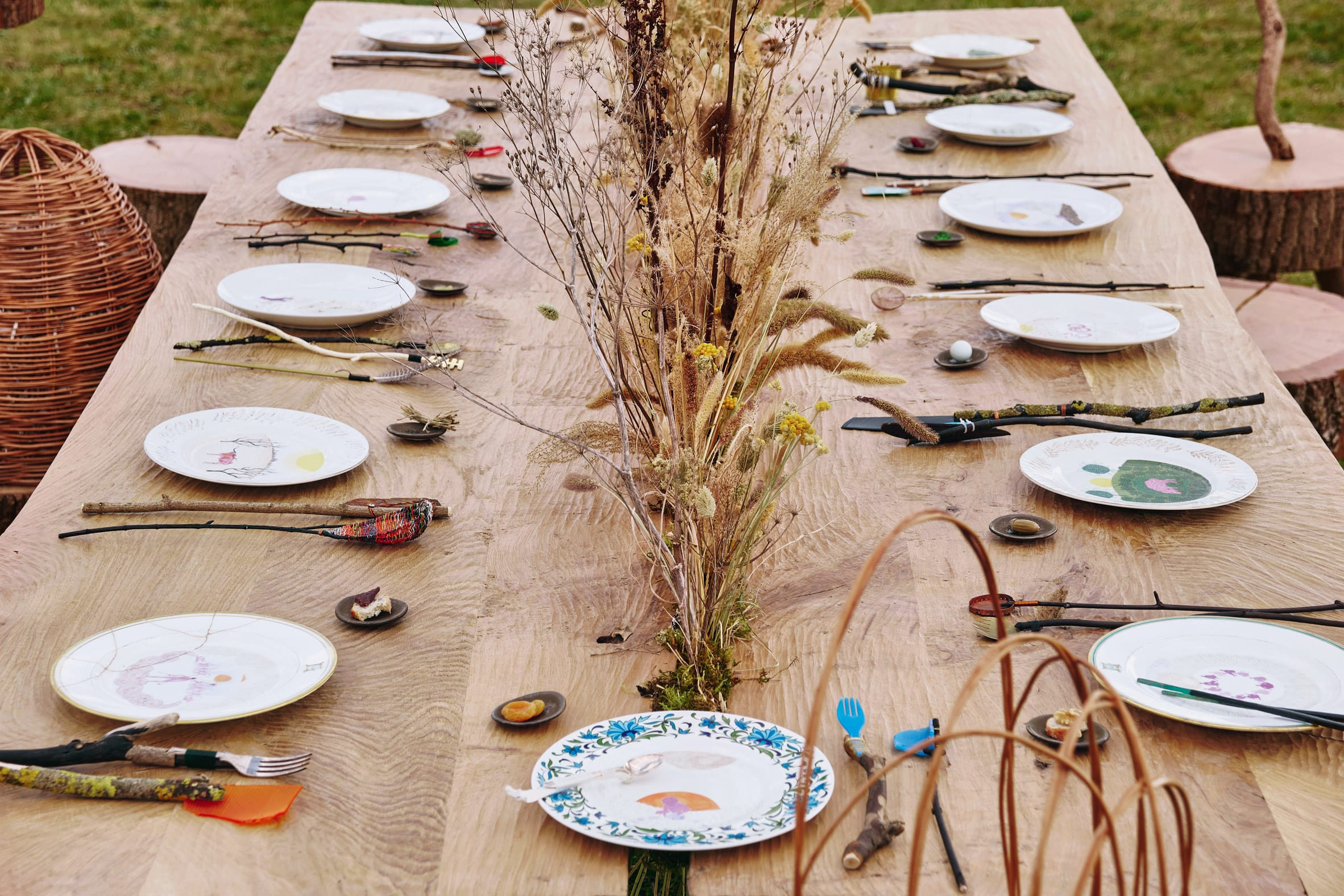 Multi-species table setting with ceramic plates in Venice Architecture Biennale installation by Superflux