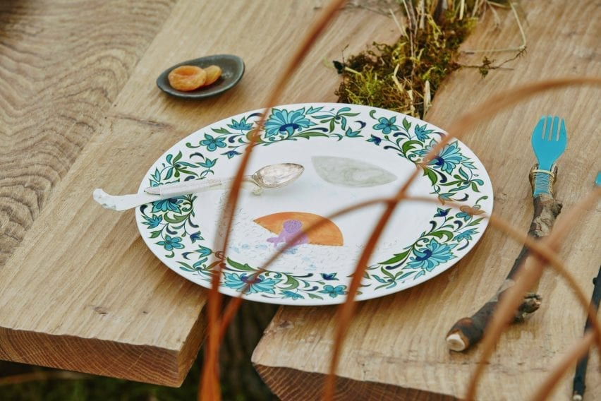 Close-up of table setting with illustrated ceramic plate in Venice Architecture Biennale installation by Superflux