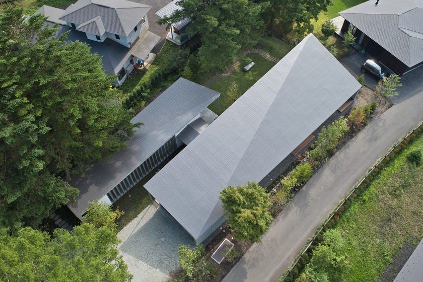 Roofs of Symbiotic House for Life After Retirement by READ & Architects