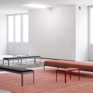 Red and black furniture sit atop rugs