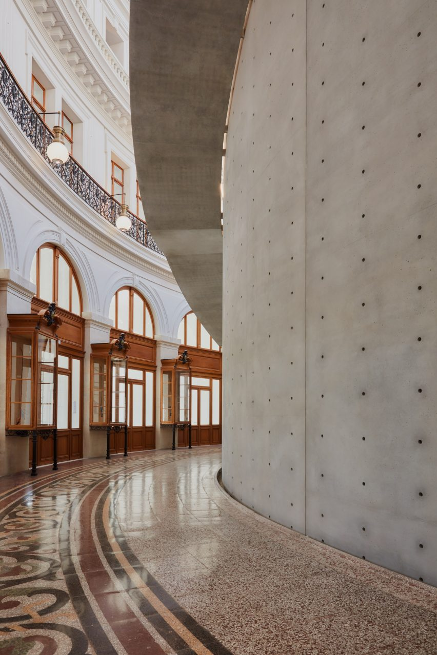 Concrete abruptly joins the decorative tiled floor