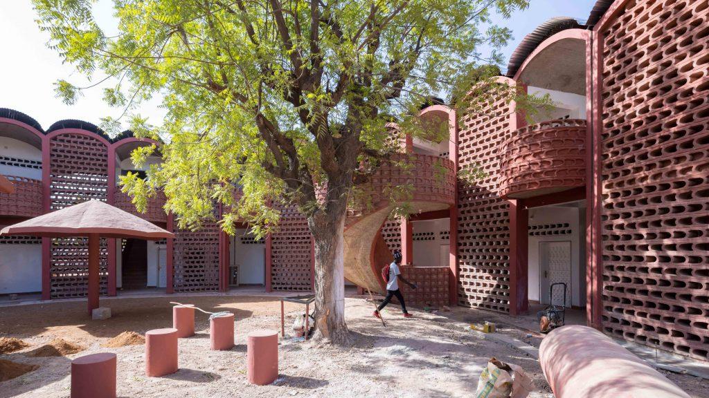 Manuel Herz encloses curvilinear hospital in Senegal with lattice brickwork