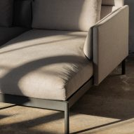A modular sofa unit with grey upholstery