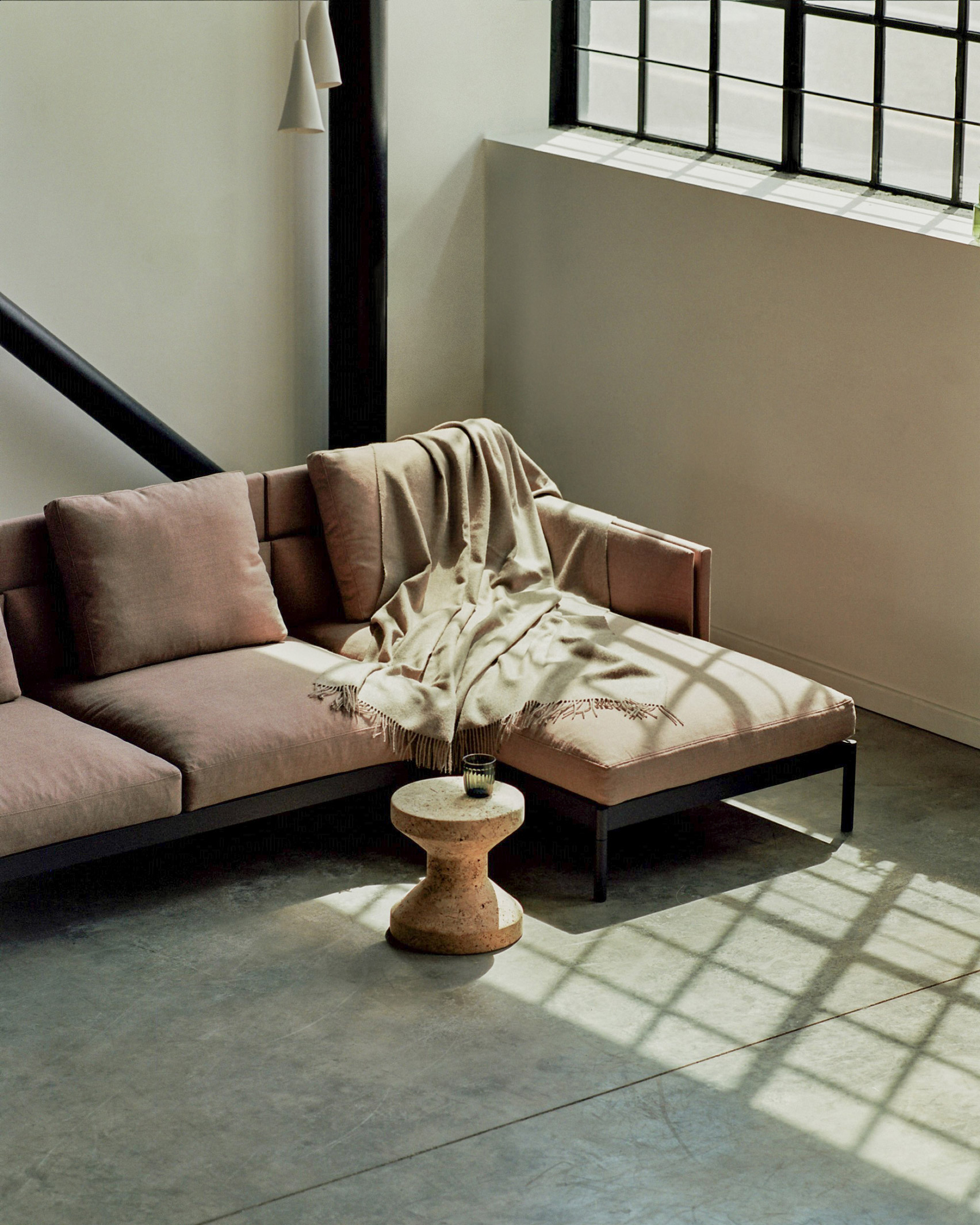 A dusky pink sofa with a chaise longue by Part & Whole