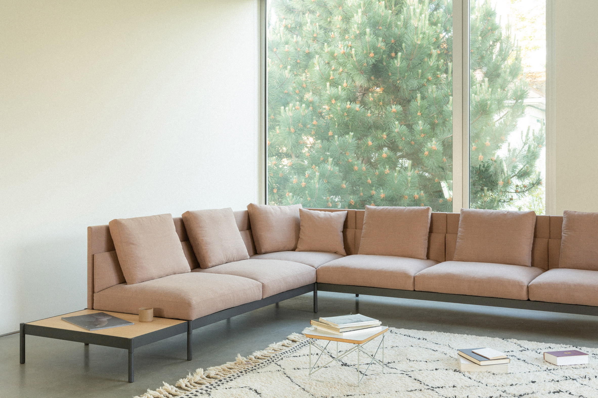 A large corner sofa with dusky pink upholstery