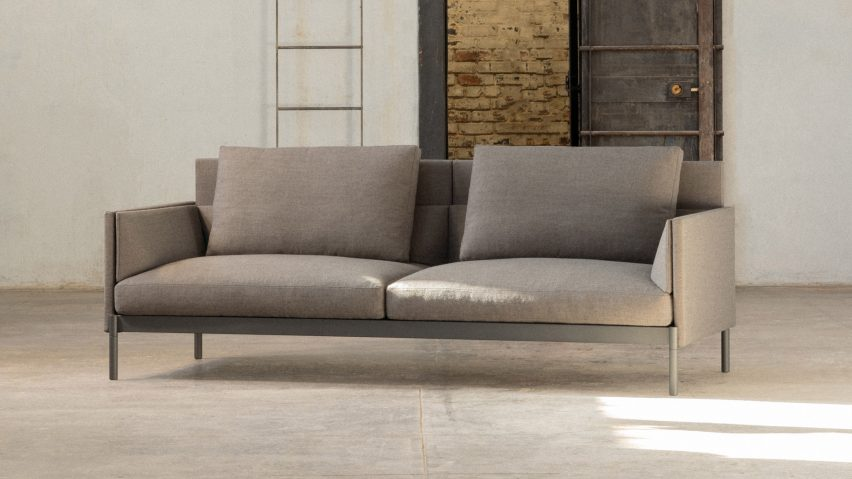 A sofa with light grey upholstery by Part & Whole