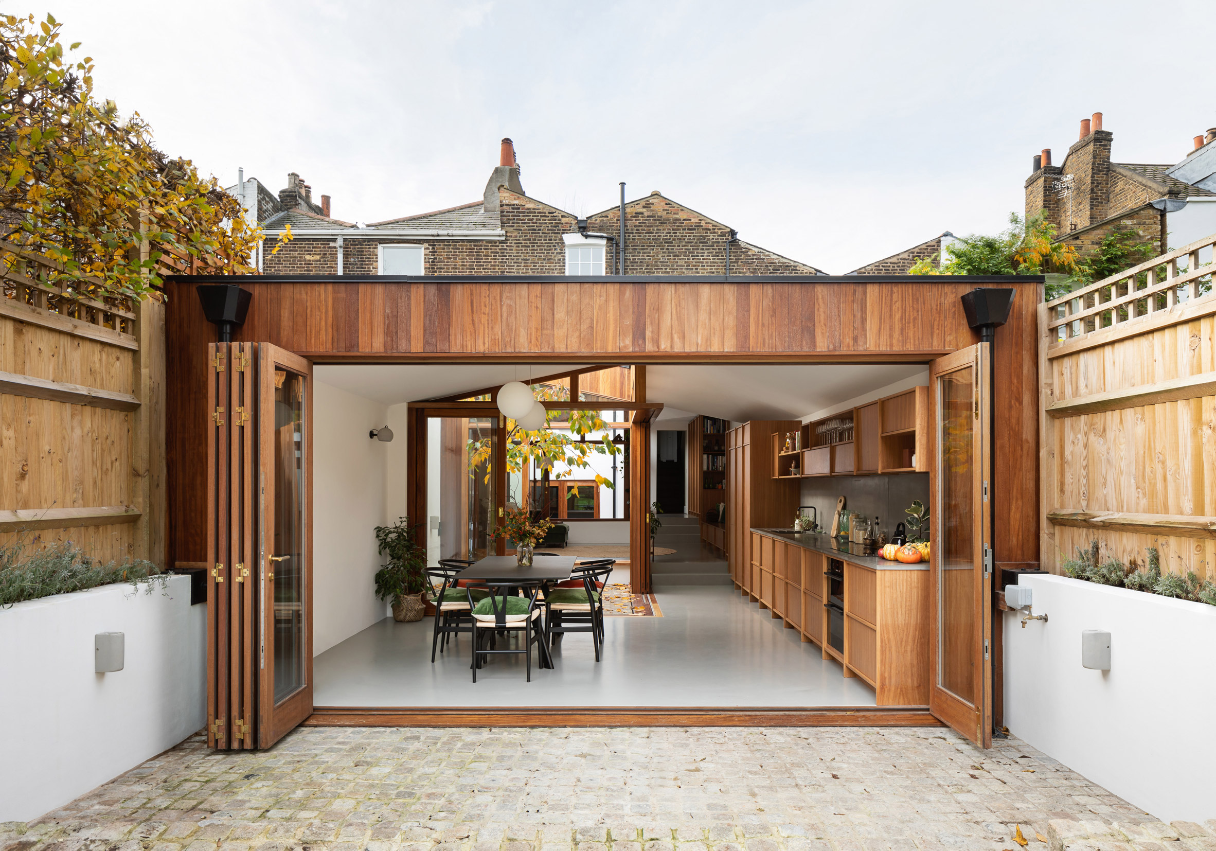 The wood-clad extension of A Cloistered House