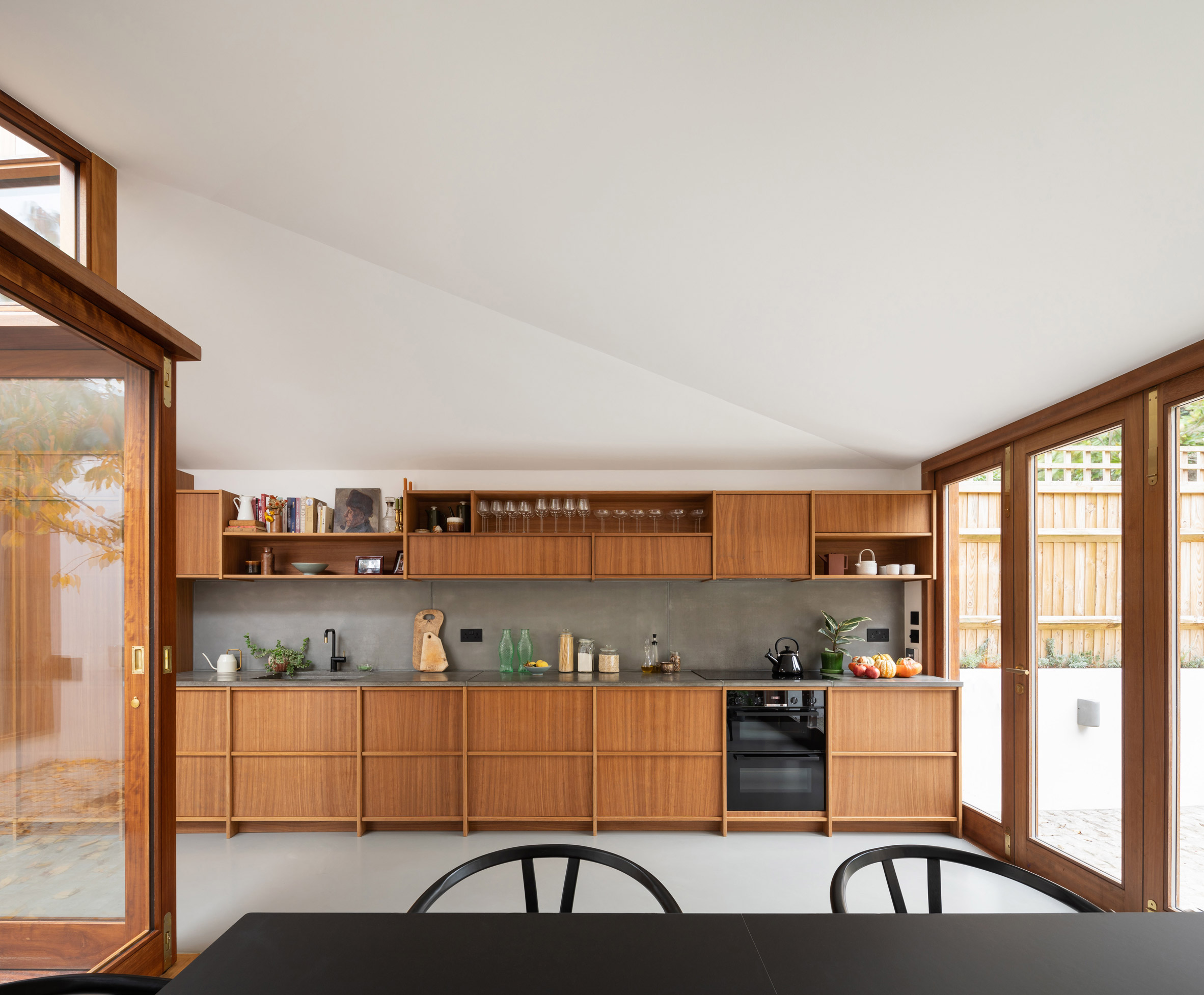A wooden kitchen that stretches the length of a wall