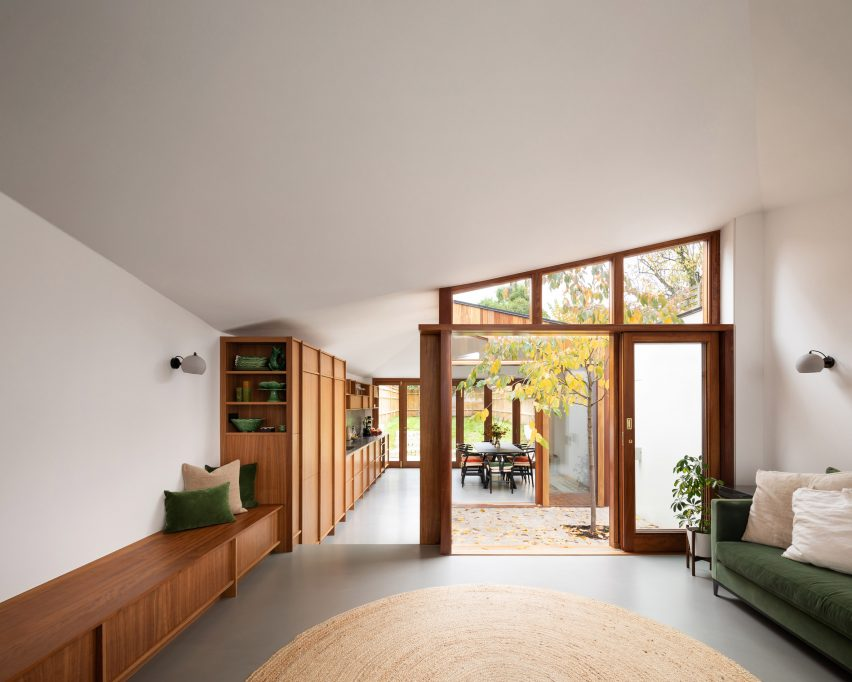 A living room punctured by a courtyard