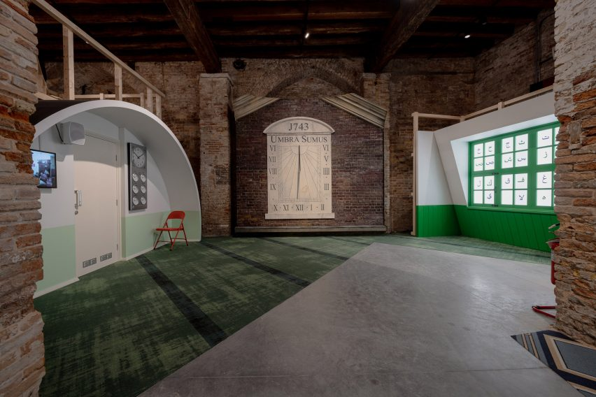 A sundial is mounted on the wall of the Three Mosques exhibition