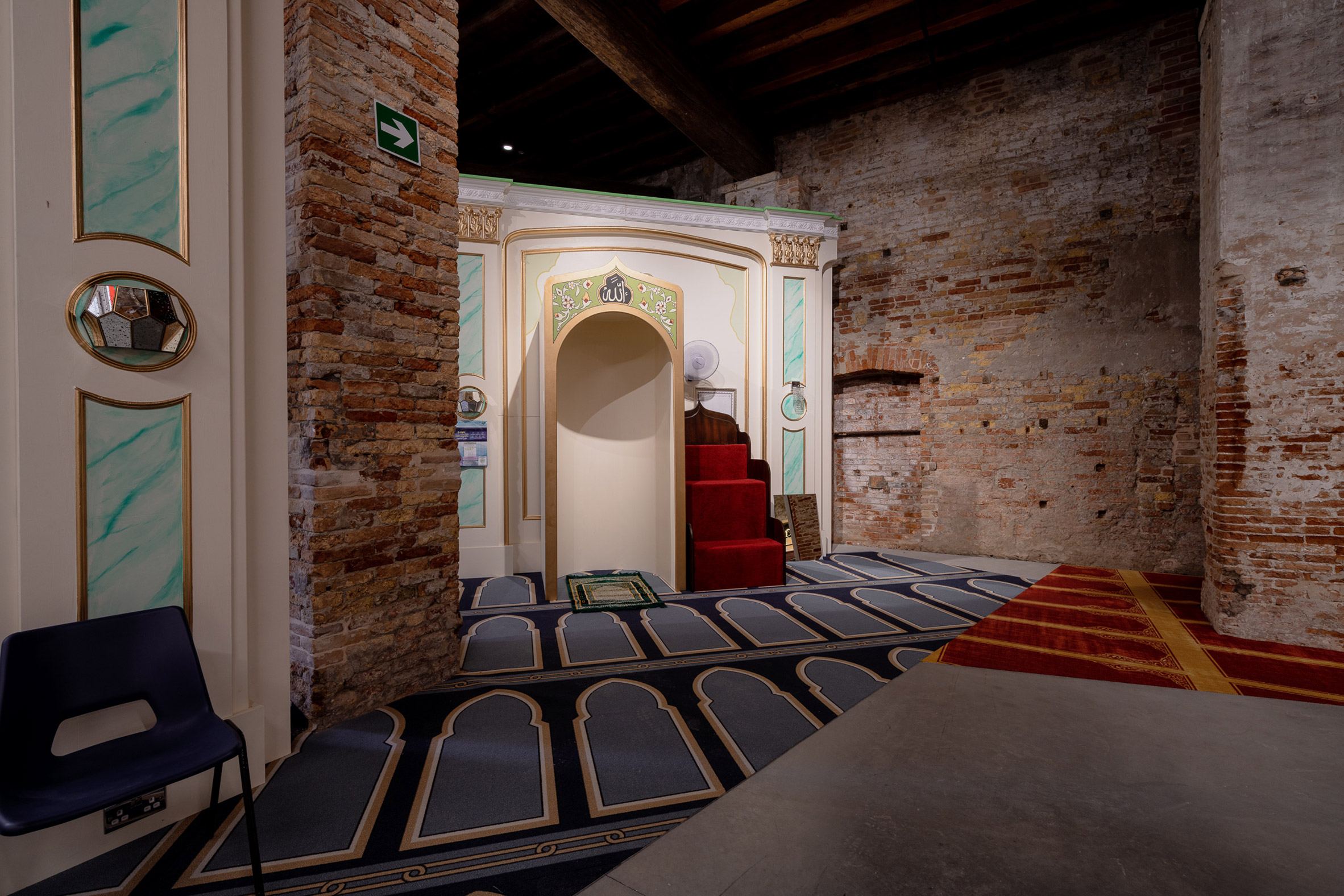 The models were placed within an exposed brick room