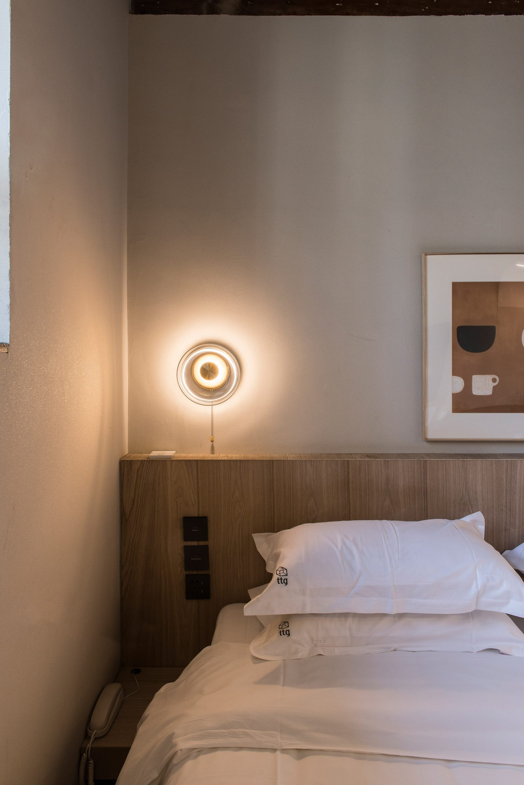 Guest bedroom in renovated hutong hotel by Fon Studio