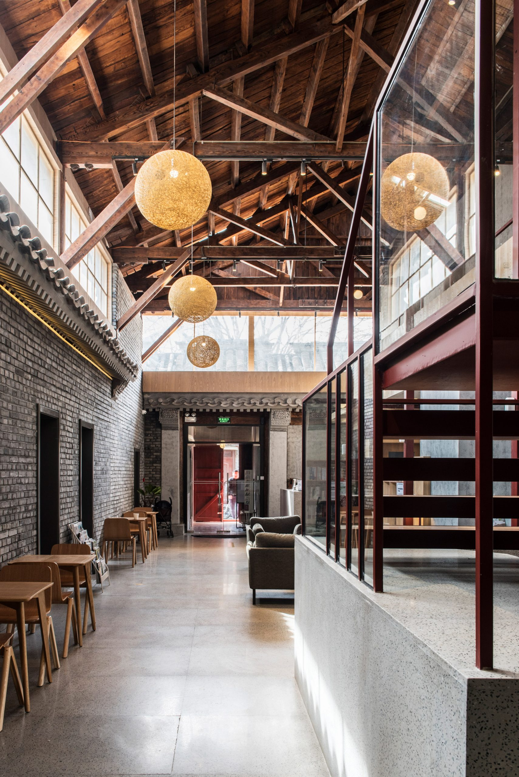 Interior courtyard with wooden roof and clerestory windows windows in Well Well Well Hotel