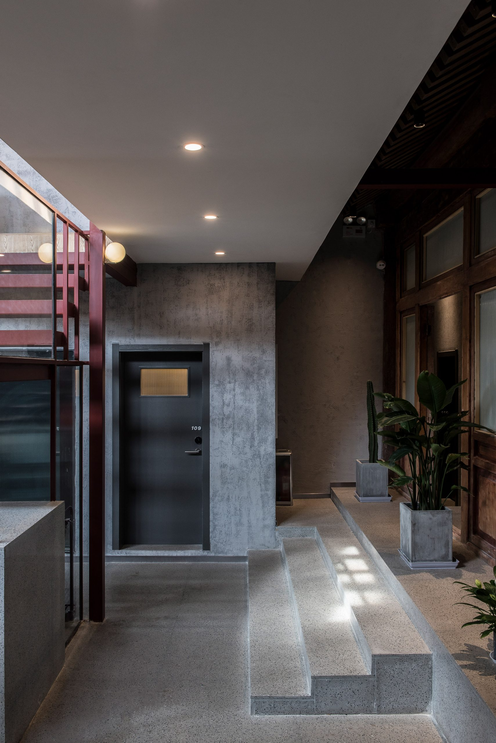 Concrete stairs to guest rooms in Well Well Well Hotel