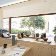 A wooden living space in the What We Share exhibition