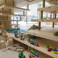 A wooden play area inside the What We Share exhibition