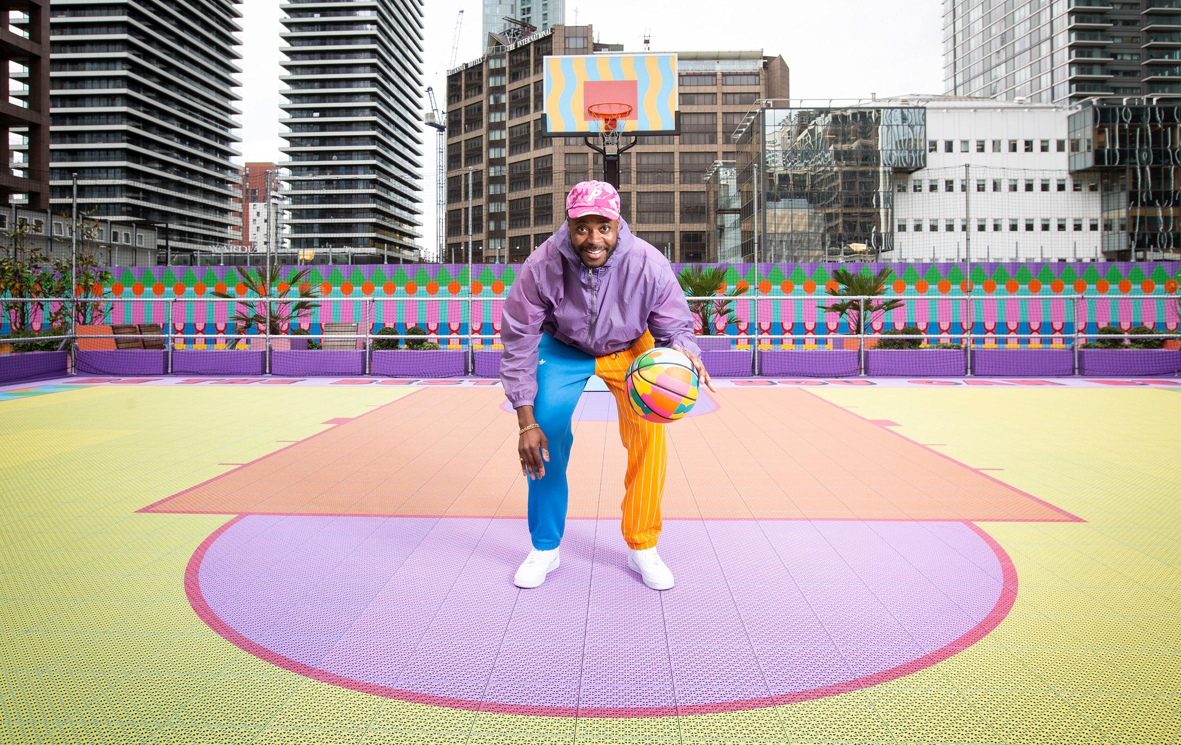 Yinka Ilori dribbling on colourful basketball court