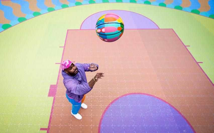 Yinka Ilori throwing printed basketball