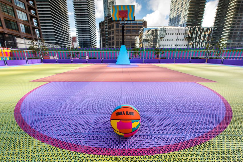 Closeup of 3D-printed sports tiles by OnCourt in purple, yellow and pnik