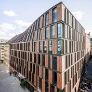 Twisting facade connects historic Stockholm building with red-brick office by 3XN