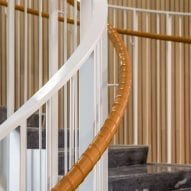 A curving bannister lines the staircase