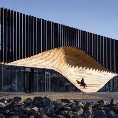 A wooden facade with integrated seating
