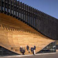 An undulating wooden facade